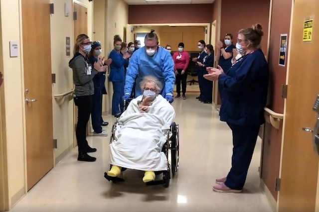 'Tough cookie' 79-year-old coronavirus patient discharged as hospital staff cheers